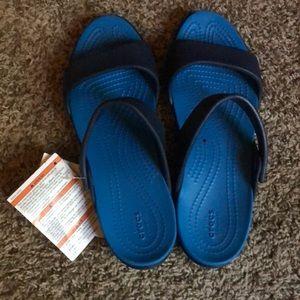 Blue croc sandals size 9